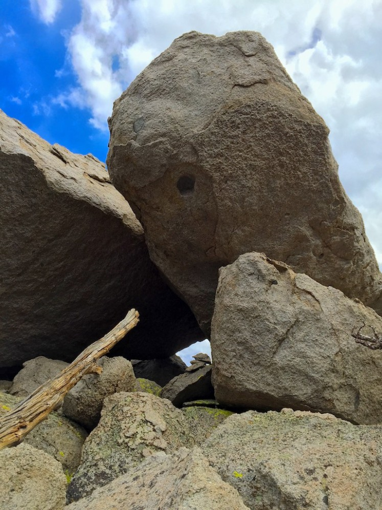Peak is reached by going through the tunnel toward the sky under the boulders